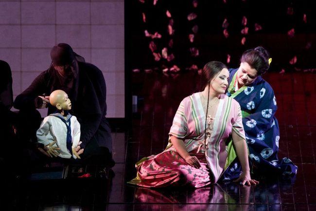 """Patricia Racette as Cio-Cio-San with Cio-Cio San's child (Blind Summit Theatre) in Puccini's """"Madama Butterfly.""""  Photo: Marty Sohl/Metropolitan Opera"""
