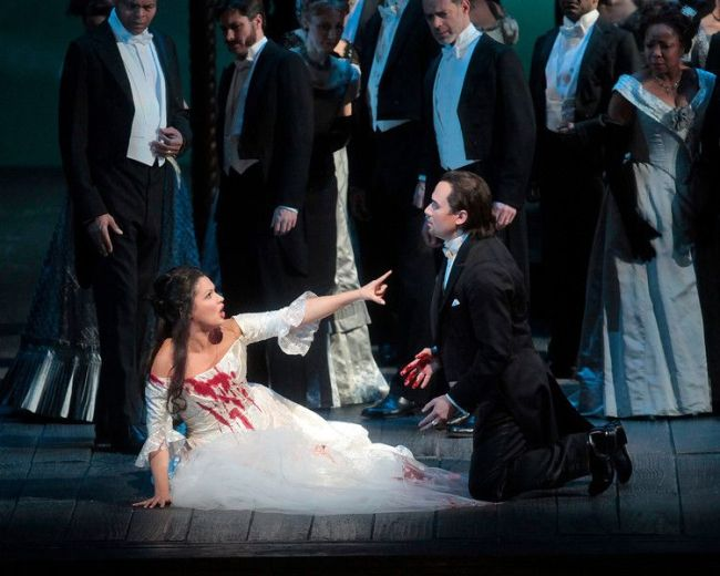 "Anna Netrebko in the title role and Mariusz Kwiecien as Enrico in Donizetti's ""Lucia di Lammermoor."" Photo: Ken Howard/Metropolitan Opera"