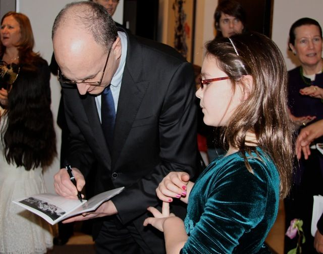 Mr. Gelb signing Lucy's playbill