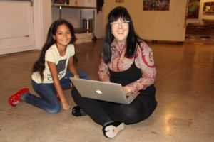 Layla & Cyndie looking at pics of Layla when she was 1 years old at Hi Art!