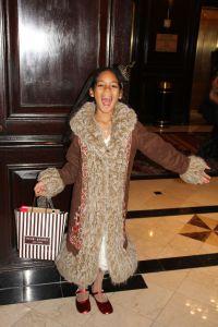 Joyful Layla in the lobby of the hotel