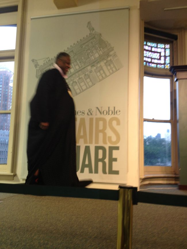 Andre Leon Talley approaching the stage