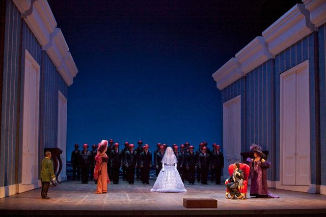 "A scene from Act 1 of Rossini's ""La Cenerentola."" Met Principal Guest Conductor Fabio Luisi conducts Joyce DiDonato and Juan Diego Flórez. Photo: Ken Howard/Metropolitan Opera"