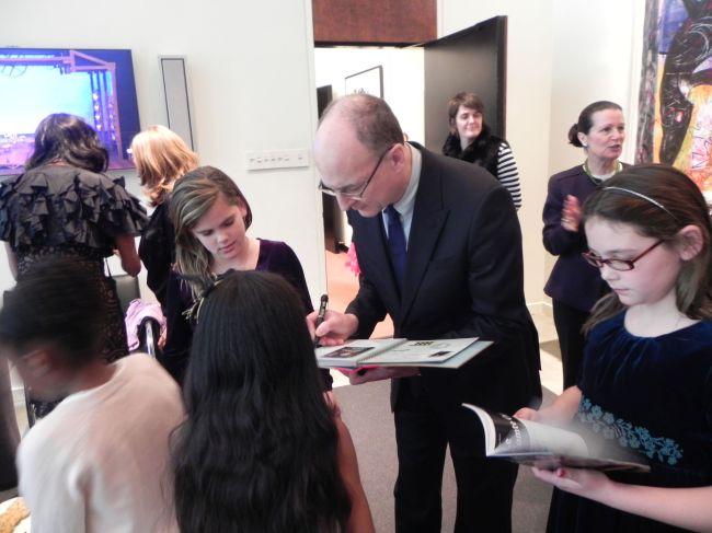 Peter Gelb signing Isabel's scrapbook