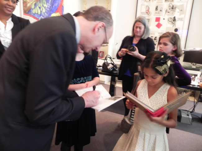 Peter Gelb signing Layla's scrapbook