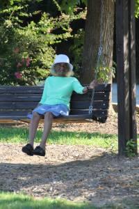 Grandma Sewell taking a break on the swing