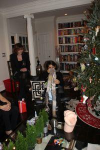 Jennifer opening a Secret Santa Present