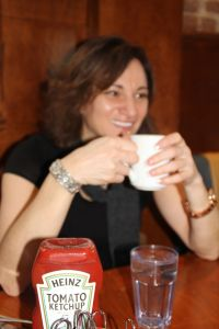 Roula with a cup of coffee