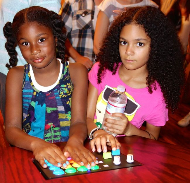 Grace and Layla operating the interactive light and sound installation