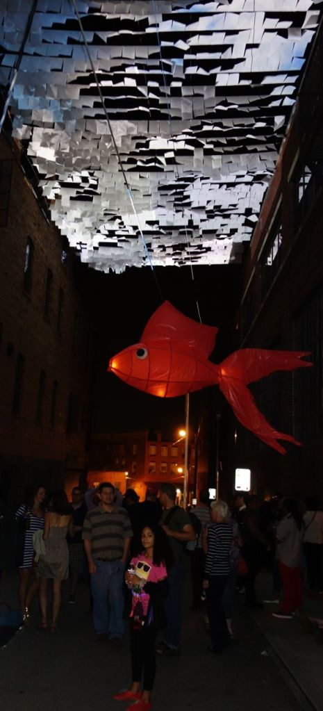 Micah & Whitney Stansell - An Inversion (with sky and land)- a video installation where daylight suddenly occupies a street within the night with a giant goldfish