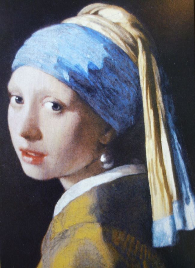 """Photo of postcard of Johannes Vermeer's """"Girl with a Pearl Earring,"""" Oil on canvas ca.1665"""