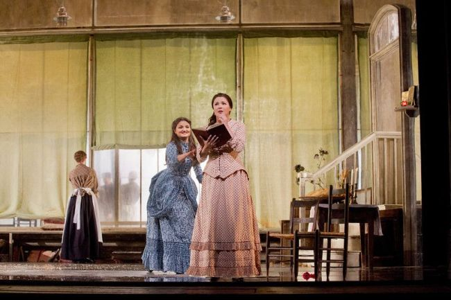 "Oksana Volkova as Olga and Anna Netrebko as Tatiana in Tchaikovsky's ""Eugene Onegin."" Photo: Ken Howard/Metropolitan Opera"