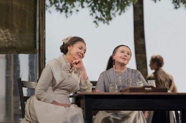 """Elena Zaremba as Mme Larina and Larissa Diadkova as Filippyevna in Tchaikovsky's """"Eugene Onegin."""" Photo: Ken Howard/Metropolitan Opera"""