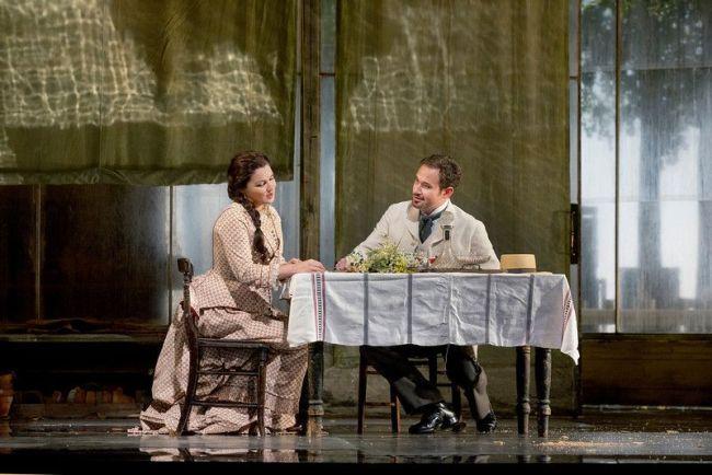 "Anna Netrebko as Tatiana and Mariusz Kwiecien as the title character of Tchaikovsky's ""Eugene Onegin."" Photo: Ken Howard/Metropolitan Opera"