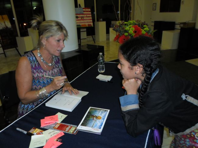 Alison signing Layla's book