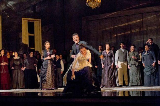"Elena Zaremba as Mme Larina, Piotr Beczala as Lenski, and Oksana Volkova as Olga in Tchaikovsky's ""Eugene Onegin."" Photo: Ken Howard/Metropolitan Opera"