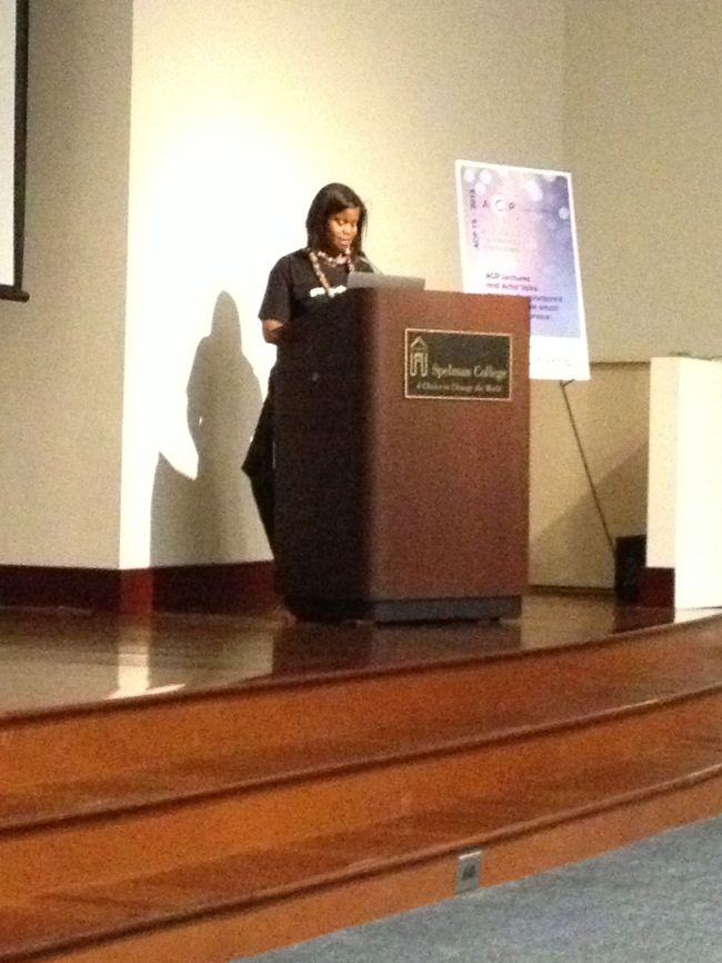 Curator of Spellman Fine Art Museum making opening remarks