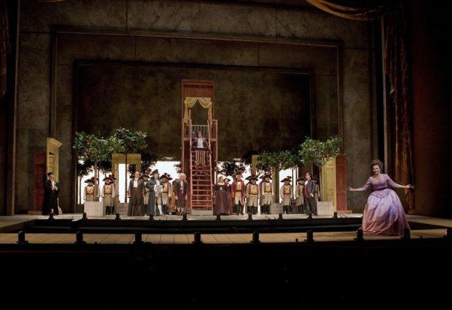 "A scene from the Act 2 finale of Rossini's ""Il Barbiere di Siviglia"" with Isabel Leonard (front) as Rosina. Photo: Ken Howard/Metropolitan Opera"