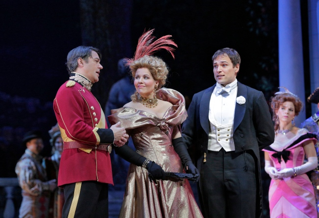 Nathan Gunn as Danilo, Renée Fleming as Hanna and Alek Shrader as Camille de Rosillon in Lehár's The Merry Widow. Photo credit: Ken Howard/Metropolitan Opera