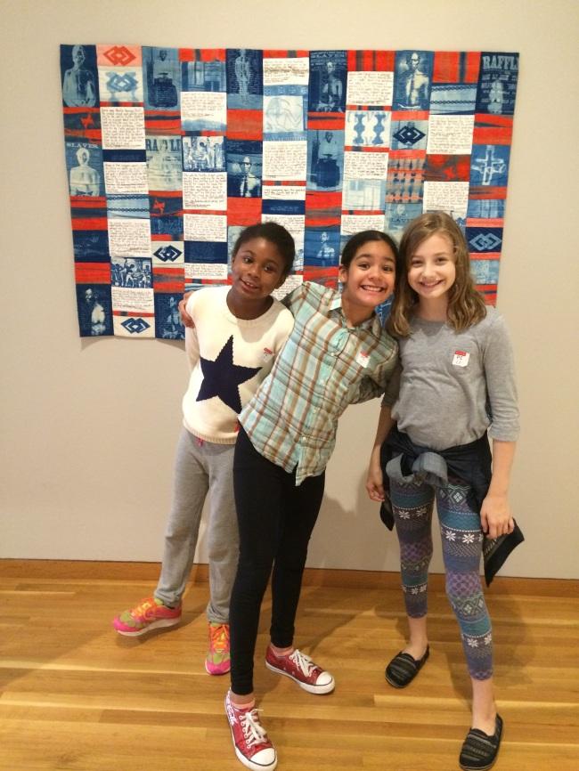 Grace, Layla and Lia with the quilt