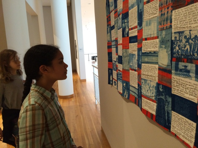Layla reading the quilt